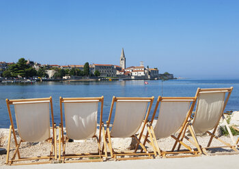 Croatia, Istria, Porec, Old town, Euphrasian Basilica, beach loungers in the foreground - WWF04438