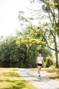 Young woman running in a park - MOEF01545