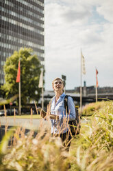 Woman with backpack and tablet in the city - MOEF01563
