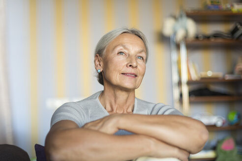 Portrait of smiling senior woman relaxing at home - VGF00119
