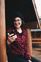 Portrait of smiling young woman using mobile phone - INGF06929
