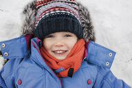 Close-up portrait of girl wearing warm clothing - CAVF54309
