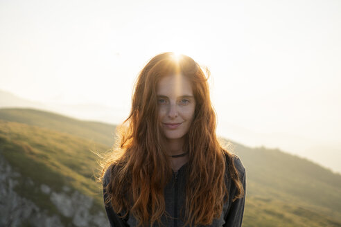Portrait of smiling red-haired woman - AFVF01944