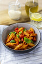 Penne with tomato and basil in bowl - GIOF04821