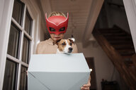 Boy wearing Superhero mask with Jack Russel Terrier in - KMKF00655