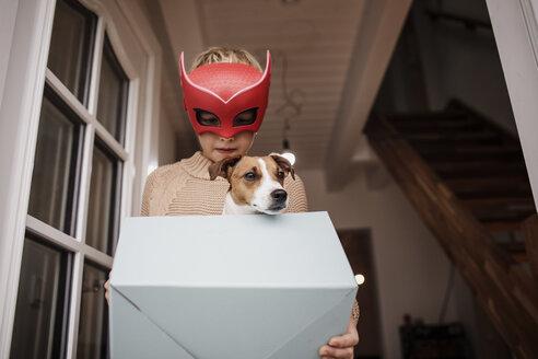 Boy wearing Superhero mask with Jack Russel Terrier in - KMKF00655