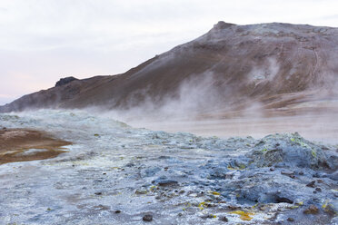 Steaming blue coloured mud pools with Namafjall in the background, at Hveraröndor Hverir Geothermal Area, at Namaskard Pass in Iceland. - AURF07848