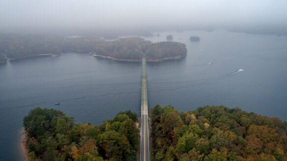 Aerial view of Browns Bridge over Lake Sidney Lanier during foggy weather - CAVF55130