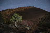 Scenic view of mountain against star trails at Sunset Crater Volcano National Monument - CAVF55652