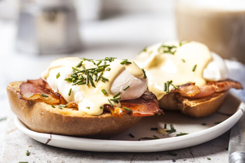 Traditional egg benedict with slices of bacon on toast,  poached egg and hollandaise - SBDF03826
