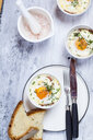 Oefs en cocotte (Individual baked eggs) with spinach, feta, bacon, eggs, and slices of bread - SBDF03832