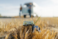 Camper van key on stubble field in rural landscape - GUSF01472