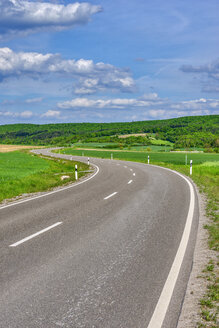 Winding road in the countryside, Bavaria, Germany - RUEF02042