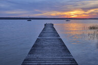 Wooden jetty at sunset at Lake Ammersee, Fuenfseenland, Bavaria, Germany. - RUEF02048