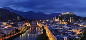 Austria, Salzburg, Monchsberg with Hohensalzburg fortess at dusk - RUEF02063