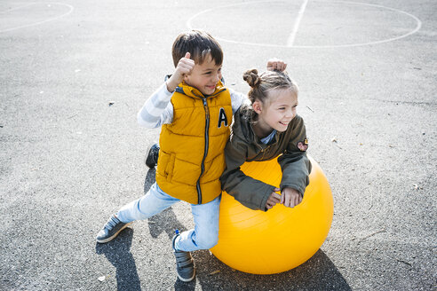 Two children having fun with gym ball - HMEF00094