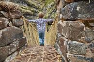 Peru, Quehue, boy crossing rope bridge - SSCF00049