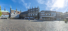 Germany, Schleswig-Holstein, Luebeck, Town hall and market square against the sun - FRF00772