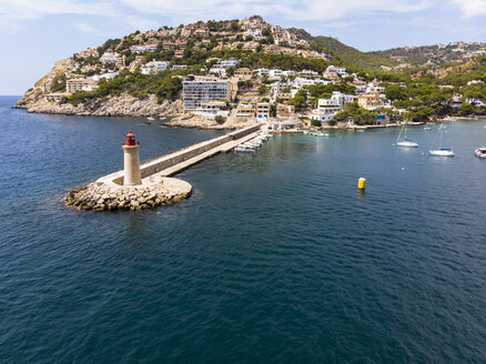 Spain, Balearic Islands, Mallorca, Andratx Region, Aerial view of Port d'Andratx, coast and natural harbour with lighthouse - AMF06232