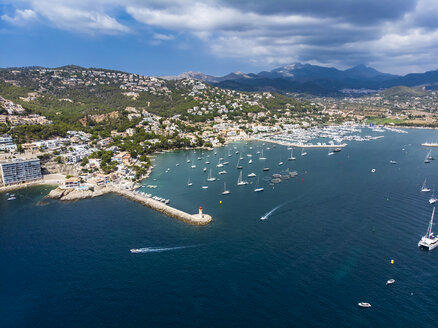 Spain, Balearic Islands, Mallorca, Andratx Region, Aerial view of Port d'Andratx, coast and natural harbour with lighthouse - AMF06238