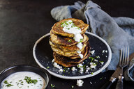 Stack of zucchini fritters with garlic yogurt sauce and feta - SBDF03862