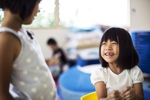 Two smiling girls in a classroom in a Japanese preschool. - MINF09635