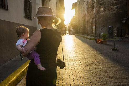 Panama, mother and baby girl visiting Panama City at sunset - RUNF00239
