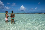 Carribean, Colombia, San Andres, El Acuario, two women standing in shallow turquoise water - RUNF00245