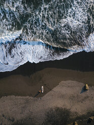 Indonesia, Bali, Aerial view of surfers at Balian beach - KNTF02351
