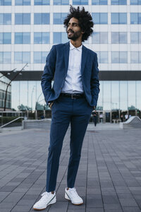Spain, Barcelona, stylish young businessman standing in the city - JRFF02072