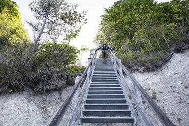 Germany, Mecklenburg-Western Pomerania, Ruegen, Jasmund National Park, HIker ascending stairs - MAMF00245