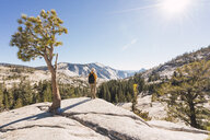 USA, California, Yosemite National Park, hiker standing on viewpoint - KKAF03017