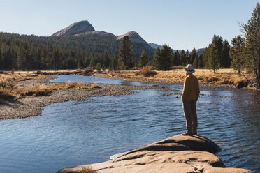 USA, California, Yosemite National Park, Tuolumne meadows, hiker on viewpoint - KKAF03020