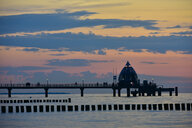 Germany, Mecklenburg-Western Pomerania, Zingst, sea bridge and dive gondola at sunset - FDF00261