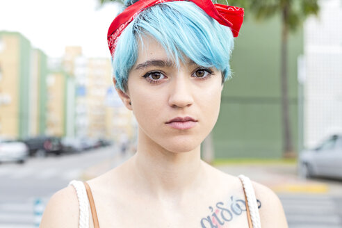 Portrait of serious young woman with blue dyed hair - ERRF00142