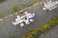 Italy, Tuscany, Siena, top view of young couple having dinner in a vineyard - FBAF00182