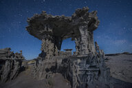 Low angle view of Tufa against star field - CAVF56060