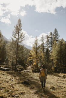 Switzerland, Engadin, woman on a hiking trip in forest - LHPF00132