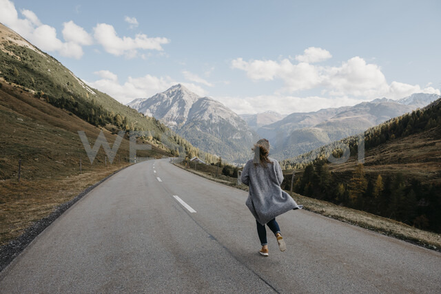 Switzerland, Engadin, rear view of woman walking on mountain road - LHPF00148 - letizia haessig photography/Westend61