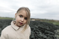 Portrait of a girl standing on a cabbage field - KMKF00667