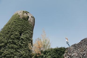 Germany, Black Forest, Sitzenkirch, young woman visiting Sausenburg Castle - LHPF00159