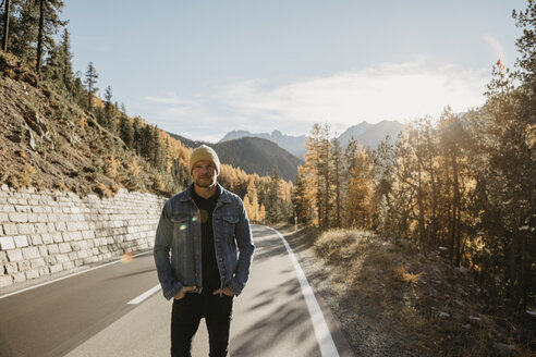 Man travelling through Switzerland, standing on road - LHPF00184