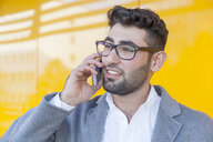 Portrait of bearded young businessman on the phone - TCF05981