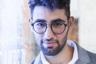 Portrait of bearded young businessman wearing glasses - TCF05996