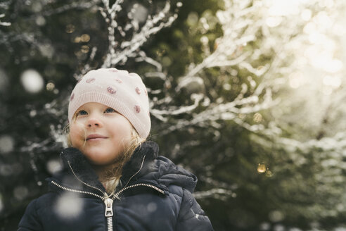 Cute girl wearing warm clothing while looking away - CAVF56543