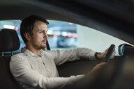 Businessman driving in his car at night - DIGF05570