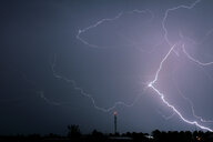 Lightning in sky at night. - INGF07933