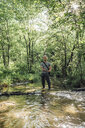 Young man fishing in a forest - VPIF01156