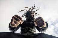 Bearded man with dreadlocks clenching fists - OCMF00118
