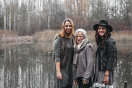 Group picture of three happy friends in autumnal nature - HMEF00115